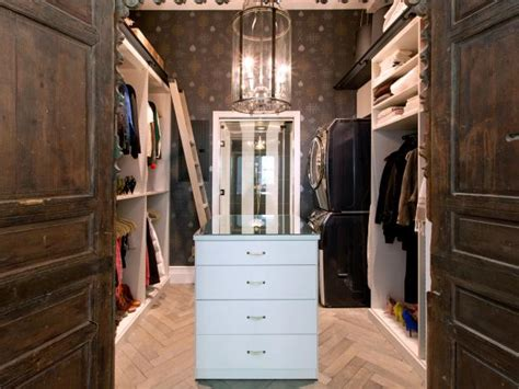 Walk In Closet Wallpaper by Walk In Closet With Island And Patterned Wallpaper Hgtv