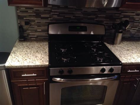 how to refinish kitchen countertops giallo ornamental light granite kitchen with cabinetry