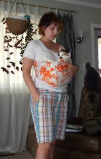 cat in baby carrier 10 cats in baby bjorns because they re really our babies