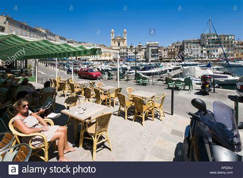 restaurant vieux port bastia cafe in the vieux port looking towards terra vecchia bastia stock photo royalty free image