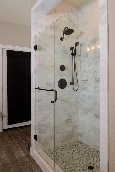 timeless glass enclosed shower  marble tile hgtv