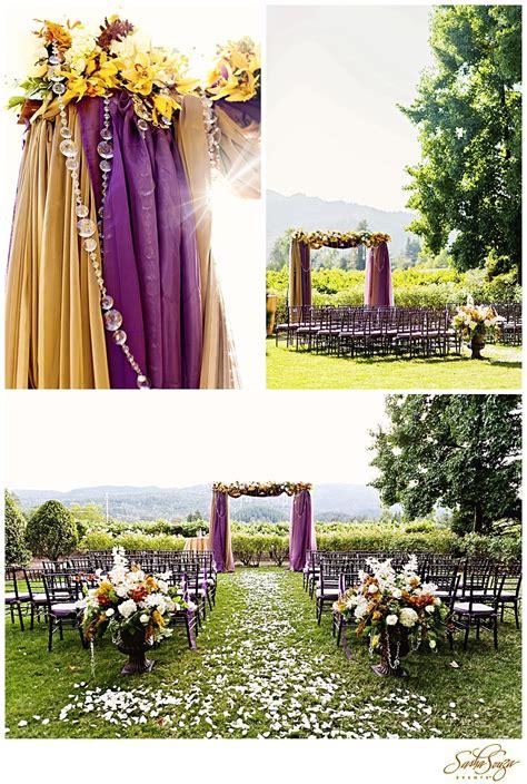 Amazing Wedding Arch With Purple And Orange Hanging Fabric