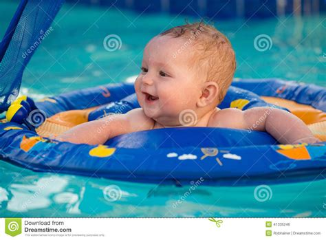 baby pool float with canopy happy infant in pool while sitting in baby float