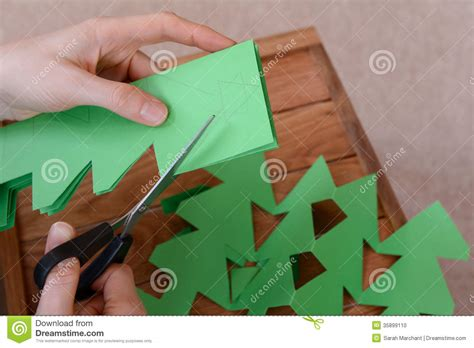 making  paper chain  christmas trees stock photo