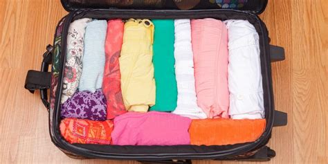 How To Fit Clothing In A Suitcase — How To Travel With