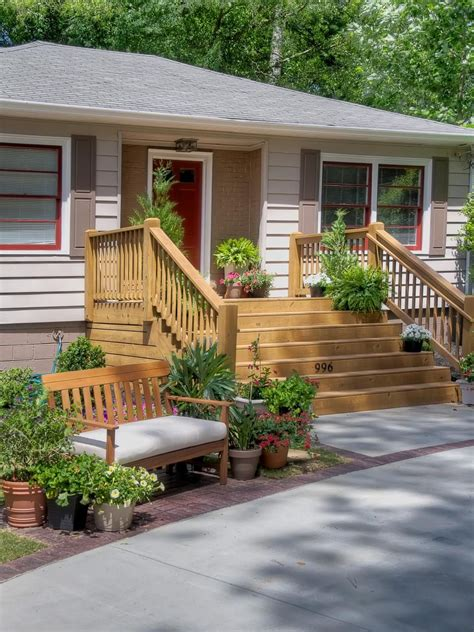 Front Porch Deck by A Wide Wooden Deck Is For Entertaining While A
