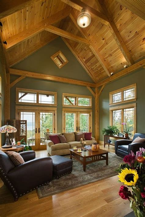 great room photo   pre designed woodhouse timber frame home sage green walls colorful