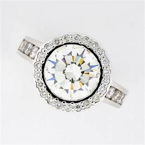 halo style engagement ring featuring round brilliant With halo style wedding rings
