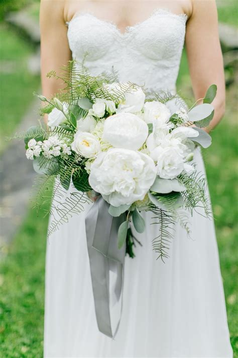 White and green wedding bouquet with gray ribbon Photo