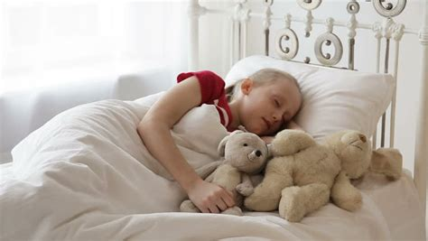 Young Girl With Toy Sleep In Bed Sheltered White Blanket