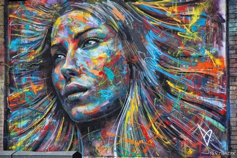 A Colorful Spray Paint Portrait Of A Beautiful Girl By