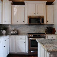 microwave  stove  raised cabinet  kitchen