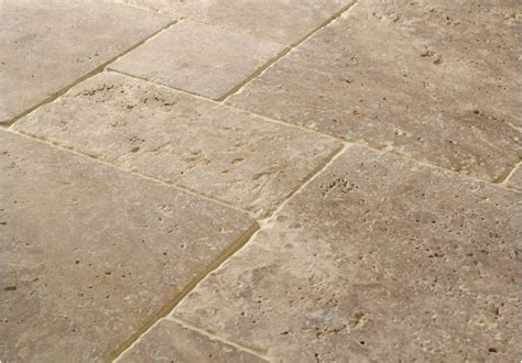 should i repair the holes in my travertine floor