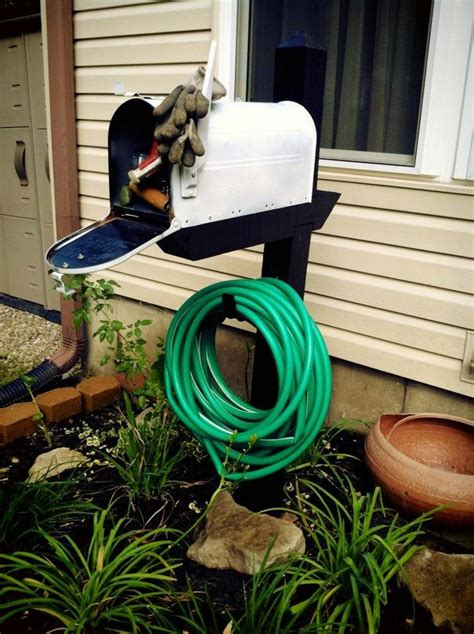 build a garden hose storage with planter diy projects