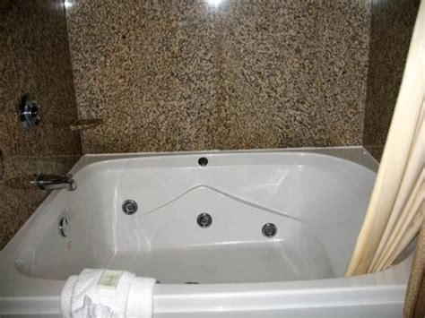 Oversized Tub by Sofa Area Picture Of Comfort Suites Dfw N Grapevine