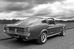 Classic 1967 Fastback Ford Mustang in black and white, a great example of sixties American ...