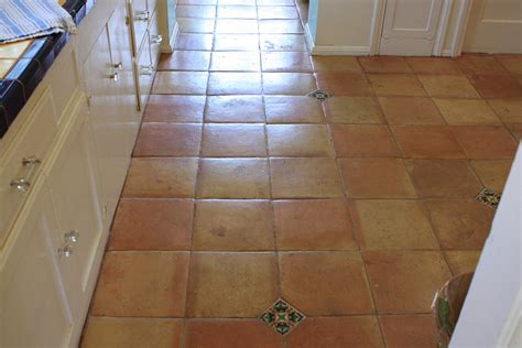 saltillo floor tile with mexican deco tile inserts