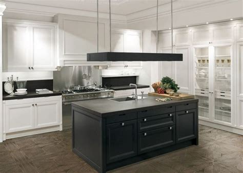white kitchen with black island hotte cuisine ilot central cuisine en image 1830