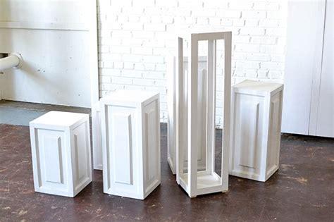 inspiration station charming ceremony designs  wooden pedestals paisley jade