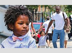 Idris Elba looks a world away from his tough guy with son