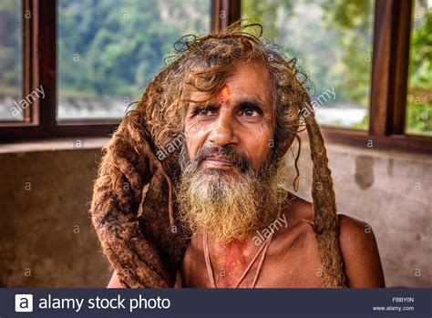 Discover the wonders of the likee. Portrait of a Sadhu baba (holy man) with traditional long hair in a Stock Photo - Alamy
