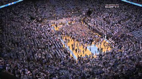 unc mens basketball fans rush court  win  duke