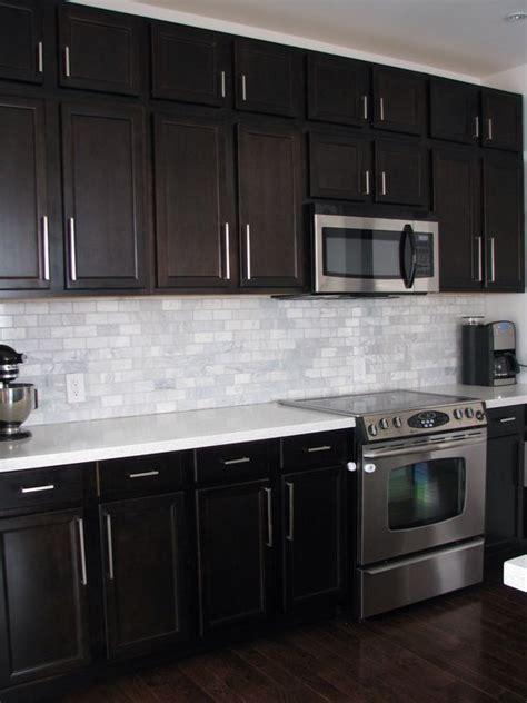 dark birch kitchen cabinets  shining white quartz