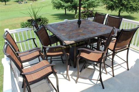 slate top bar height patio table and 8 chairs