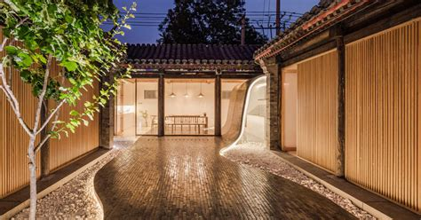 renovated historical residence features tile flowing   roof   courtyard