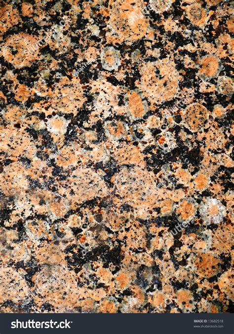 black marbled granite copper gold flecks stock photo