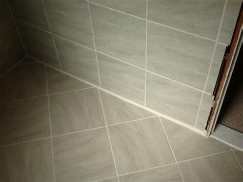 tile floor quarter quarter round tile on tile at baseboard