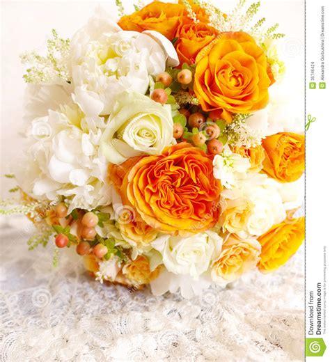 vintage orange ivory white wedding bouquet stock photo