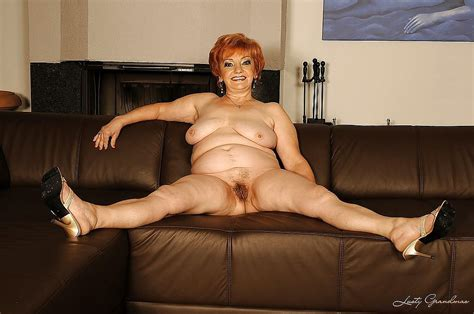 busty grandma on high heels shows her ripe tits and her hairy cunt