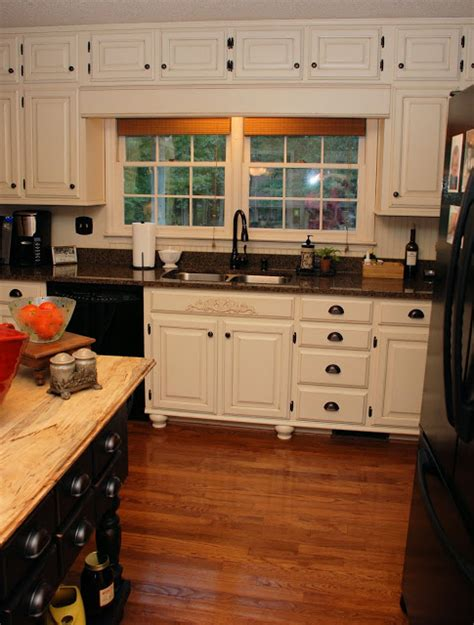 remodelaholic from oak kitchen cabinets to painted