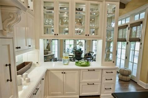 glass shelves for kitchen cabinets use glass shelves to open up space in your kansas city home 6850