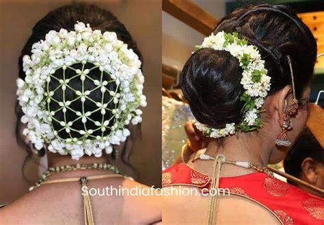 indian wedding bun hairstyle  flowers  gajra