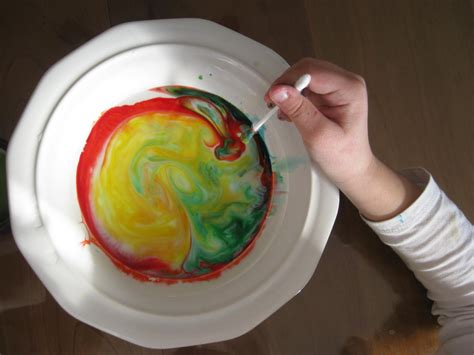 the years color mixing milk food coloring and soap