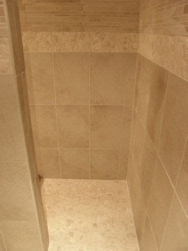 shower wall tiles ceramic staggered mosaic above an accent band and