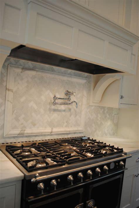 marble herringbone backsplash transitional kitchen