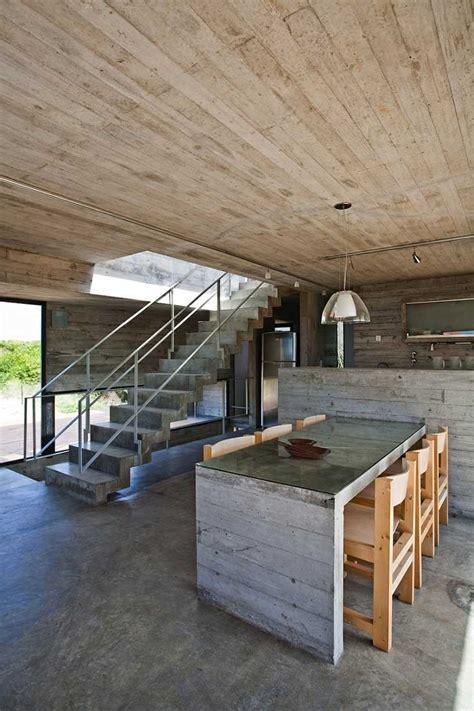 cuisine ouverte avec bar intérieurs modernes en béton et bois une alliance harmonieuse