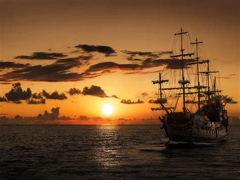 pirate ship time  piracy open sea sunset red sky dark