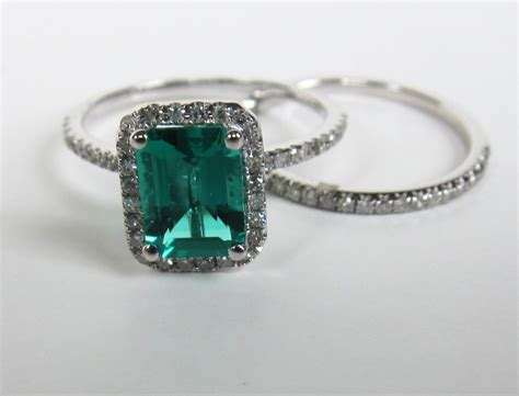 emerald cut emerald engagement ring sets  white
