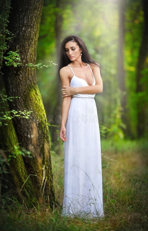 Lovely Young Lady Wearing An Elegant Long White Dress
