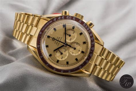 Omega Maroon we take a closer look at two gold omega speedmaster