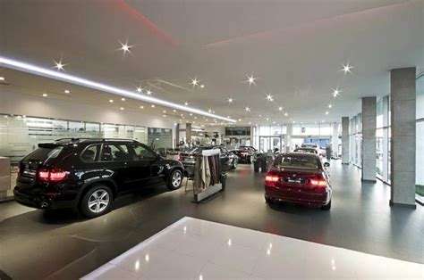 bmw dealership interior contractor for paint polish marble flooring wall paint