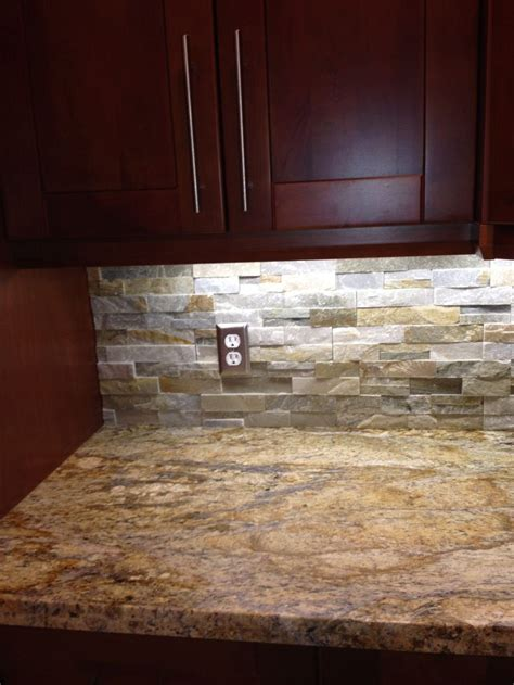 yellow river granite and quartz ledgestone backsplash