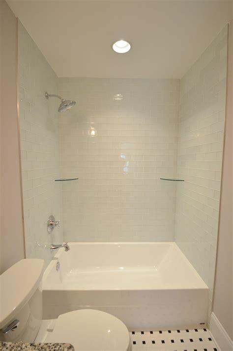 oversized tub shower combo  light blue tile shower