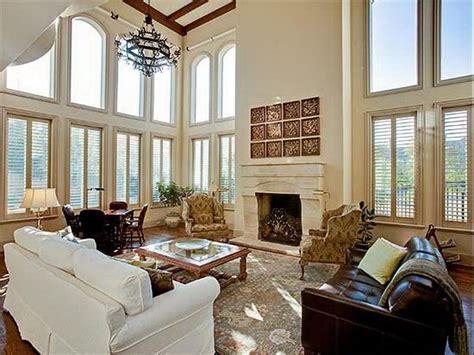 furnishing a great room decorating a great room with fireplace and high ceilings
