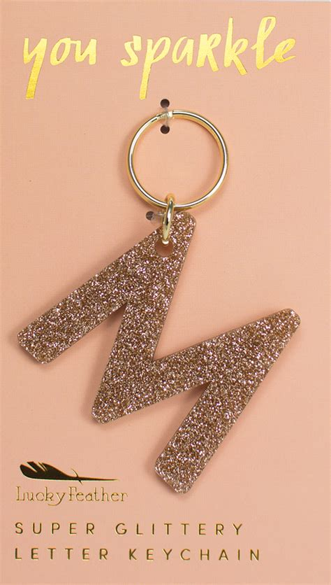 lucky feather glitter letter keychain belle  llc