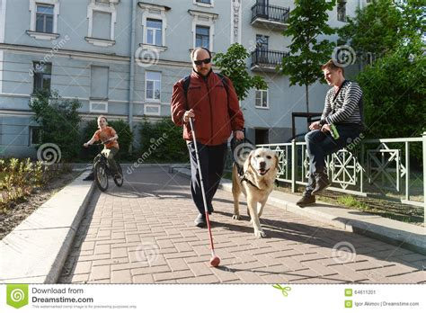 Blind Man And Guide Dog Editorial Photo